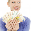 Portrait of a young caucasian woman holding money — Stock Photo #4520946