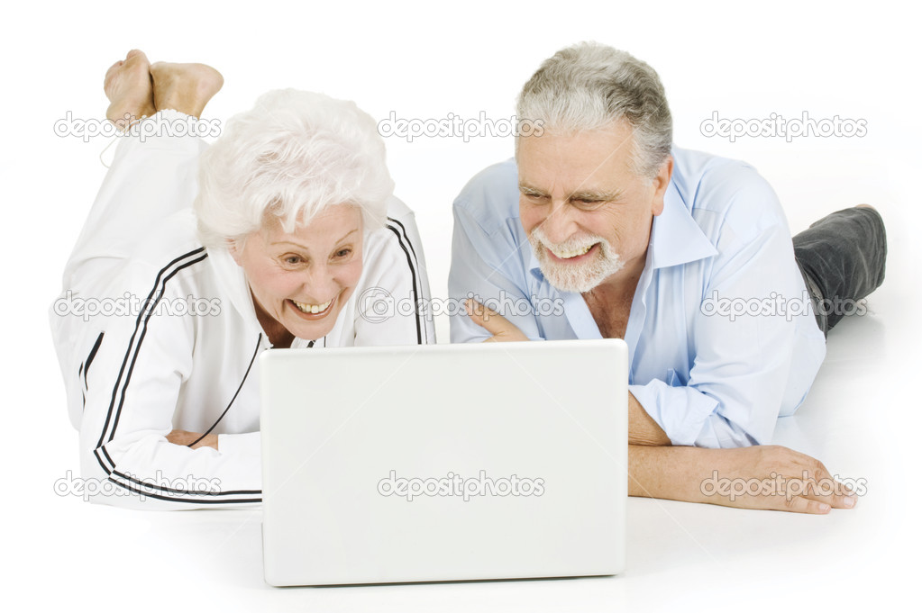 Elderly Using Facebook Elderly Couple Using Laptop