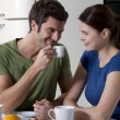 Couple having breakfast in the kitchen — Stock Photo #4830659