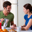 Couple having breakfast in the kitchen — Stock Photo