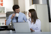 Couple drinking coffee before going to work — Stock Photo