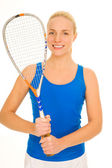 Woman with squash racquet — Stock Photo