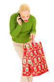 Woman with mobile and bags — Stock Photo