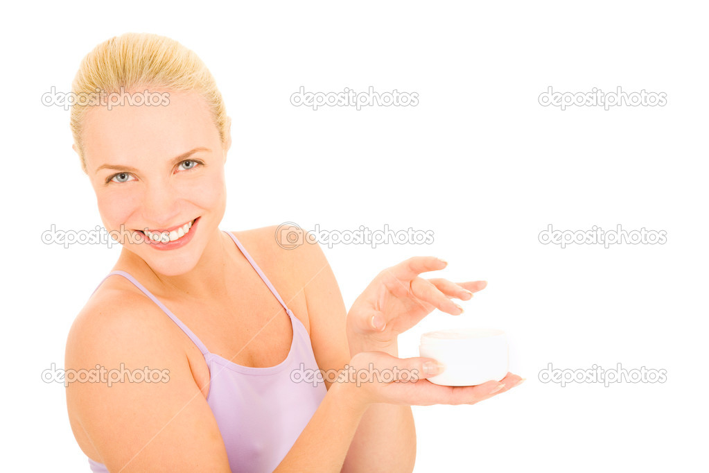 Woman holding a jar of cream in a white background — Stock Photo #4995266