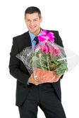 Businessman with vase of flowers — Stock Photo