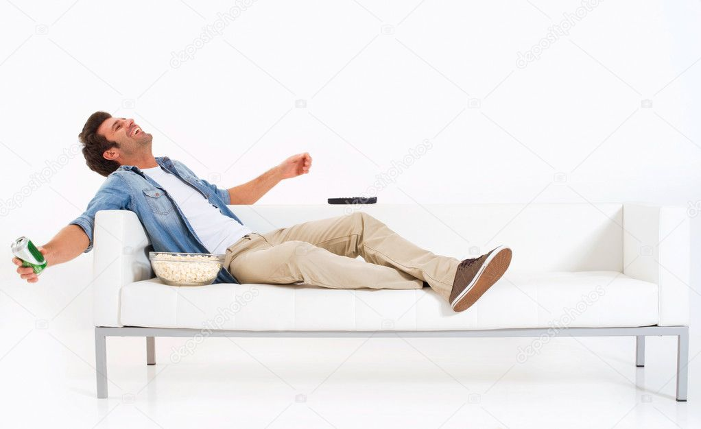 Black Man Watching tv Single Man on The Couch Watching tv in a White Background Photo by