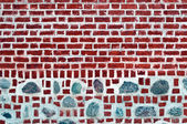 Old brick wall with stones — Stock Photo