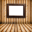 Vintage Frame in Empty Wooden Room — Stock Photo #5187561
