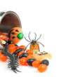 Halloween cup spilling candy — Stock Photo