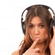 Young girl listening music in big headphones — Stock Photo #4749045
