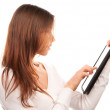 Woman typing on electronic tablet touch pad — Stock Photo