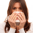 Stock Photo: Young woman holding mug of tea