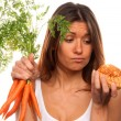 Royalty-Free Stock Photo: Woman holding bunch of fresh carrots and roll