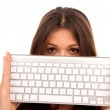 Woman holding White computer keyboard — Stock Photo #4749451