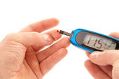 Diabetic patient doing glucose level blood test — Stock Photo