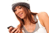 Teenage girl typing and reading text message on cell phone — Stock Photo