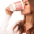 Brunette woman drinking tea coffee from mug — Stock Photo