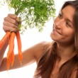 Woman holding in hand bunch fresh organic carrots — Stock Photo