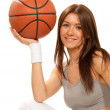 Pretty brunette woman holding Basketball in hand — Stock Photo #4880281