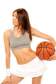 Sexy Basketball fitness brunette woman — Stock Photo