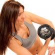 Fitness female gym instructor working out dumbbells — Stockfoto