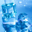 Blue melting ice cubes — Stockfoto