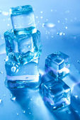Blue melting ice cubes — Stock Photo