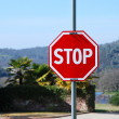 Roadside red stop sign is perfect new — Stock Photo
