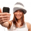 Woman with cellphone headphones thumb up — Stock Photo