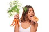 Woman Healthy vegeterian organic carrots, bun roll — Stock Photo