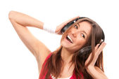 Pretty fitness brunette woman listening music and smiling — Stock Photo