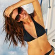 Slim sexy brunette woman speed-boat yacht — Stock Photo #5025453