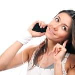 Woman talking mobile phone listening music — Stock Photo #5036016