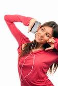 Pretty Girl Listening Music in headphones — Stock Photo