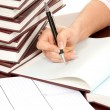 Person hand with pen signing book document — Stock Photo