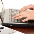 Hands typing on laptop computer keyboard — Stock Photo