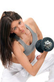 Fitness woman workout gym lifting dumbbells — Stock Photo