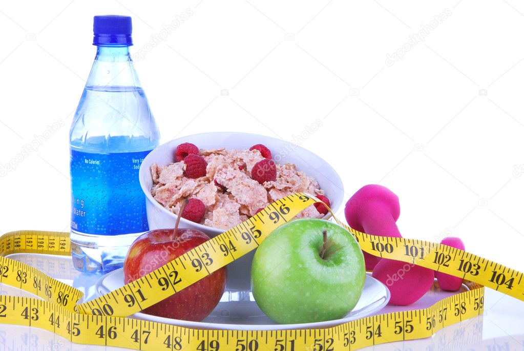 Diet weight loss concept with tape measure red and organic green apple, corn healthy rice and wheat flakes with fresh raspberries and carrot juice on a white ba — Stock Photo #5229082