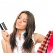 Woman holding credit card and shopping bags — Stock Photo #5239141