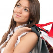 Woman holding shopping gift bags in hand — Stock Photo