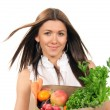Woman holding grocery bag fresh food items. - Lizenzfreies Foto