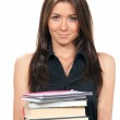 Young woman holding books, notepads in her hands — Stock Photo
