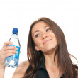 Woman holding a bottle of water in her hand — Stock Photo
