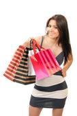 Felice bella donna sexy con regalo colorate shopping bag — Foto Stock