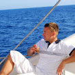 Stock Photo: Sailor relaxing on boat drinking cold coffee