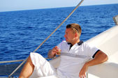 Sailor relaxing on boat drinking cold coffee — Stock Photo
