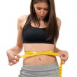 Young woman measuring her waist — Stock Photo
