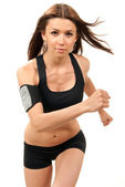 Fitness woman on diet jogging, running, walking in gym — Stock Photo
