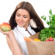 Woman holding a shopping bag full of vegetarian groceries — Stock Photo #5377521