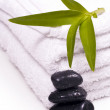 Towels and pebbles, water droplets on it. — Stock Photo